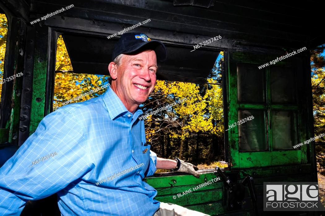 Stock Photo: Colorado Governor John Hickenlooper riding in the steam locomotive with the train engineer and fireman during a visit to the Cumbres & Toltec Scenic Railroad.
