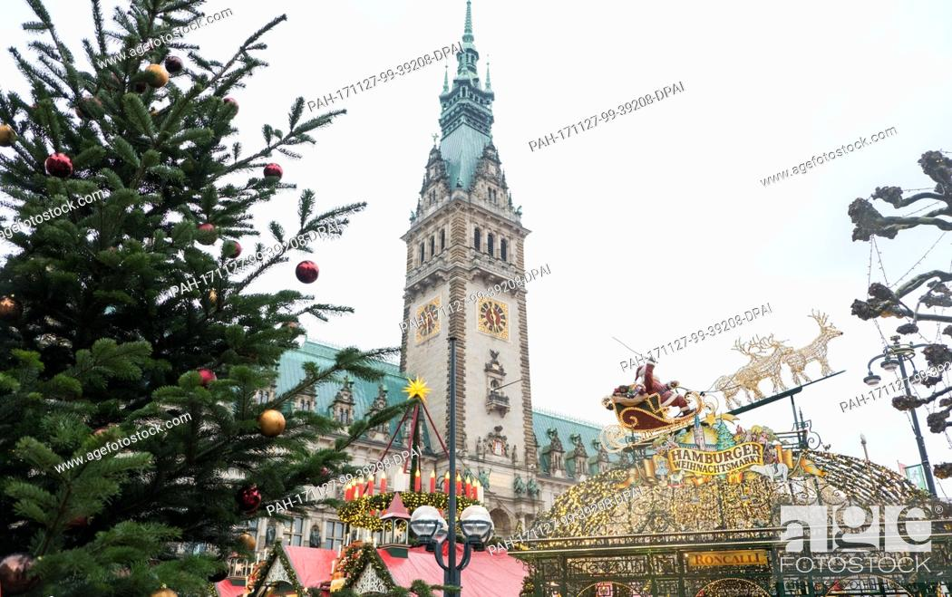 Stock Photo: A Santa Clause on a sledge hangs above the entrance to the Roncalli christmas market at the Rathausmarkt square in Hamburg,  Germany, 27 November 2017.