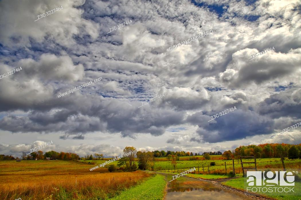 Stock Photo: Rural New Paltz Hudson Valley, NY - Landscape view with a dramatic sky after a passing storm with the bright colors of peak fall foliage. .
