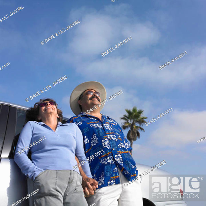 Stock Photo: Tourist couple laughing outdoors.