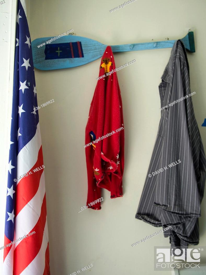 Stock Photo: Flag and hanging clothes inside a foreclosed house in Gaffney, South Carolina, United States.