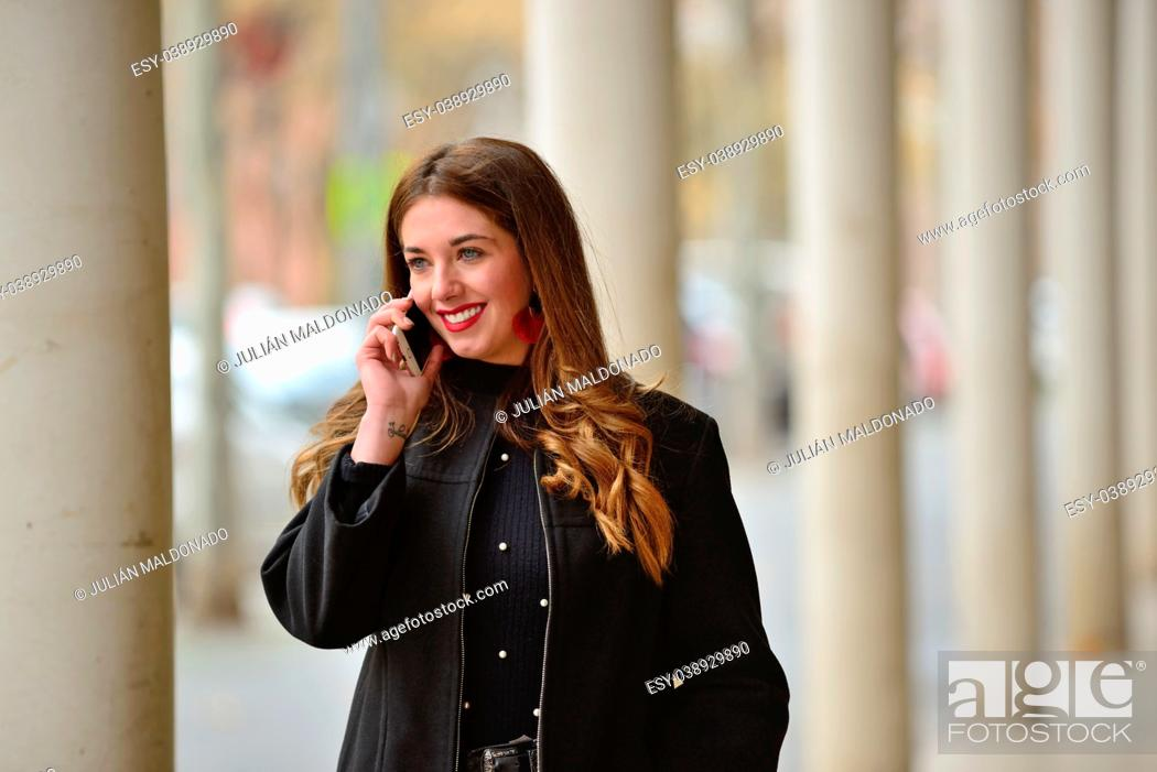 Stock Photo: Young woman communicating by mobile.