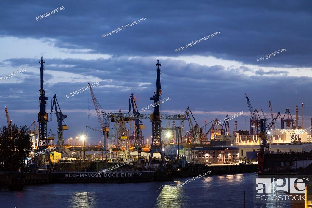 Stock Photo: Hamburg containerport at sunset.