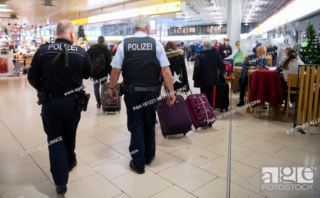 Stock Photo: 21 December 2018, Lower Saxony, Hannover: Federal policemen walk through Hanover airport. Following spying attempts at other airports and possible attack plans.