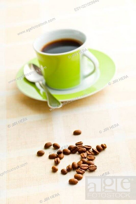 Stock Photo: coffee beans on retro tabelcloth.