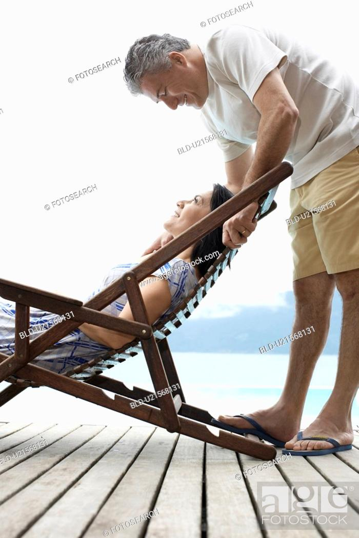 Stock Photo: Mature couple looking at each other on deck.