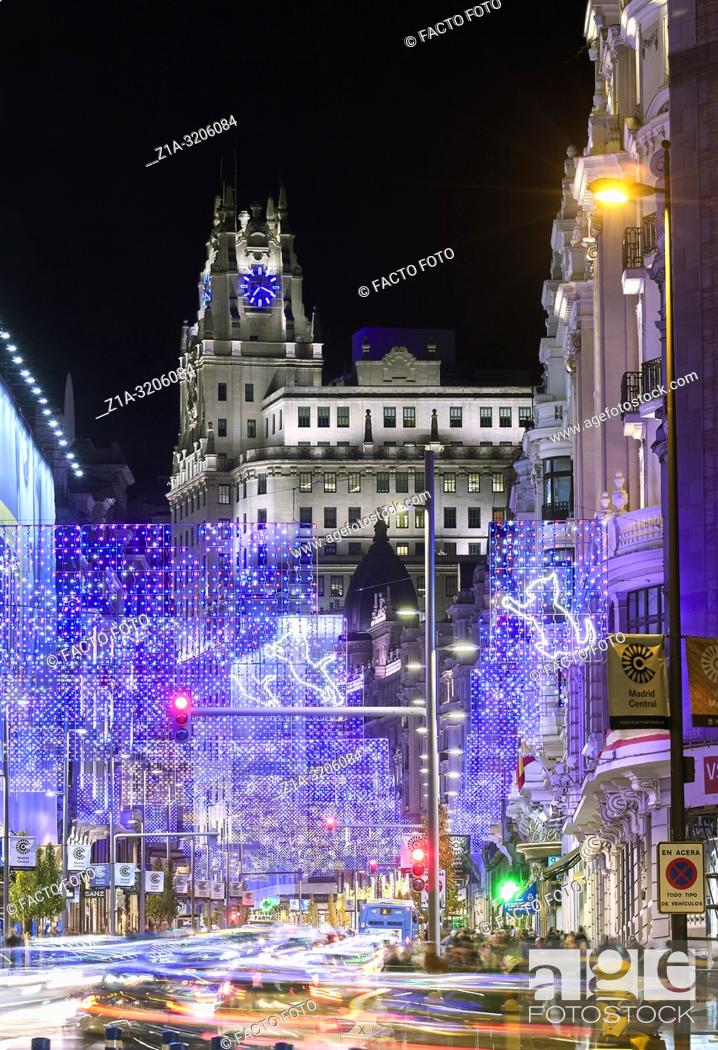 Stock Photo: Christmas lights at Gran Via street with Telefonica building at the background. Madrid. Spain.