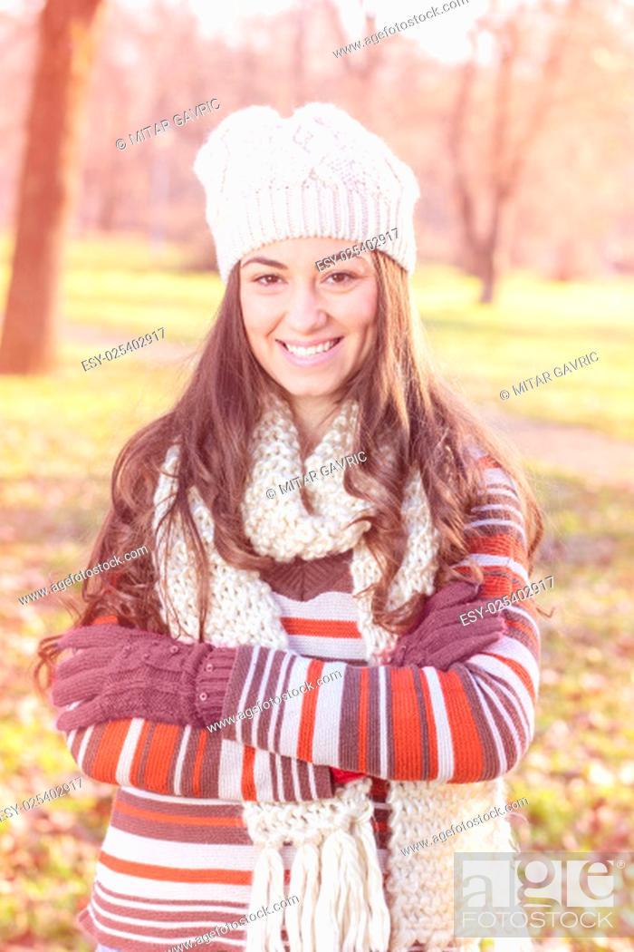 Stock Photo: Beautiful Happy Smiling Girl winter autumn season outdoor portrait. Caucasian female carefree lifestyle .