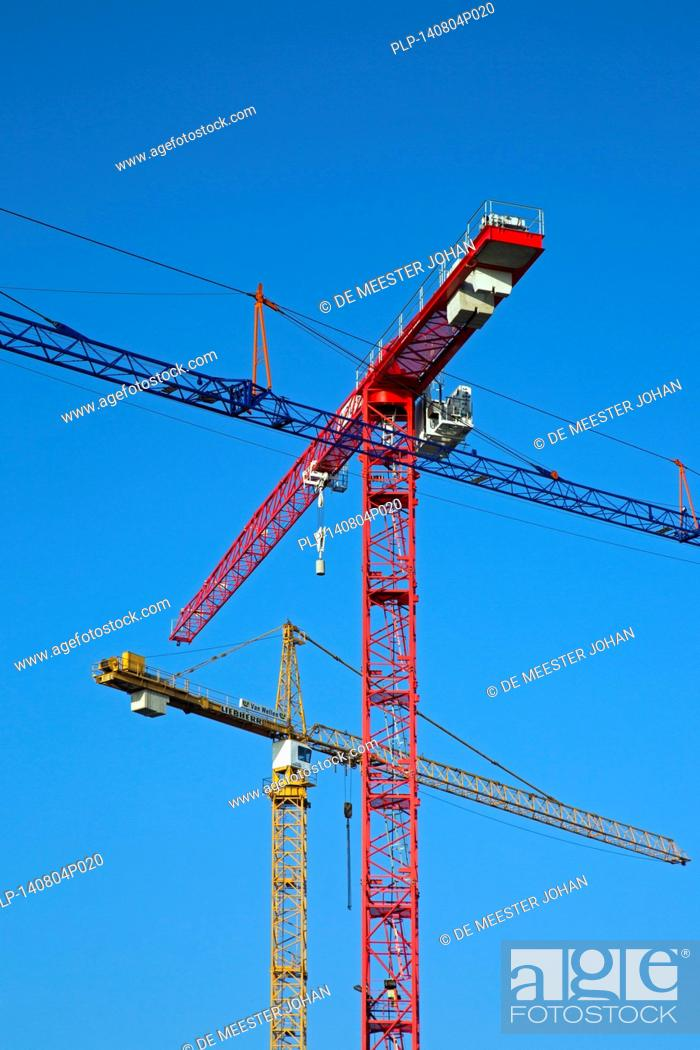 Stock Photo: Construction cranes / tower crane against blue sky.