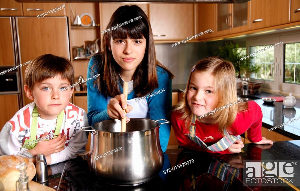 Stock Photo: Children cooking.