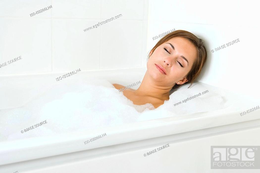 Stock Photo: Woman sleeping in bath.