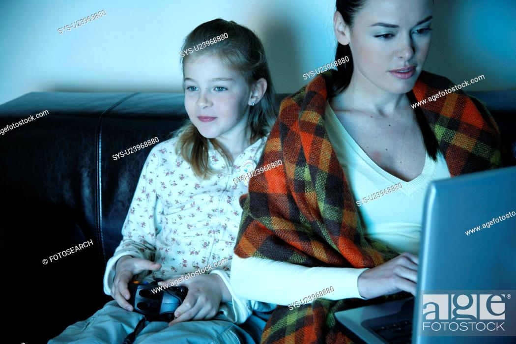 Stock Photo: Mother and daughter watching television.