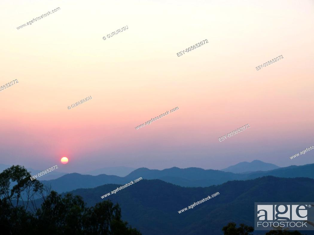 Stock Photo: Sunset in the mountains, Doi Tung, Chiang rai, Thailand.