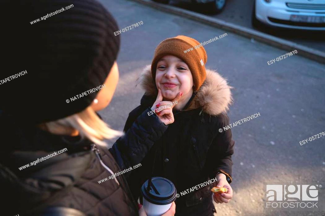 Stock Photo: Young mother with son eat street food at winter time and have a fun.