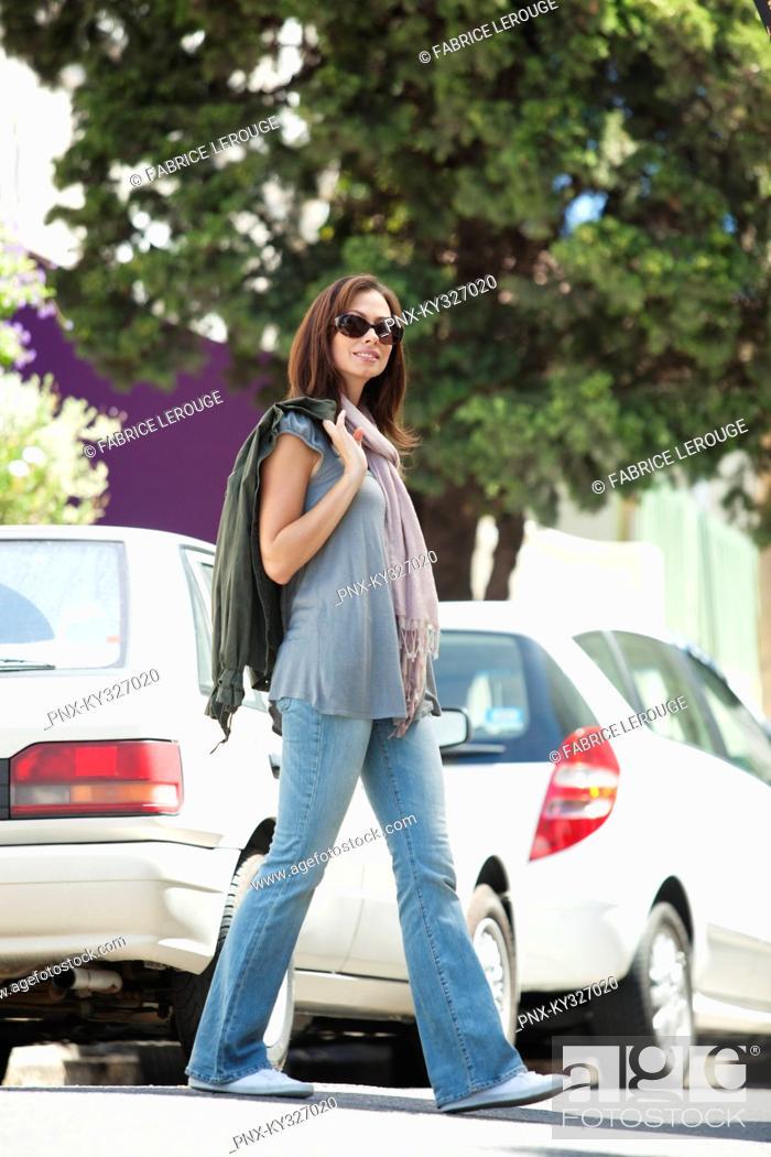 Stock Photo: Portrait of a beautiful young woman wearing sunglasses.