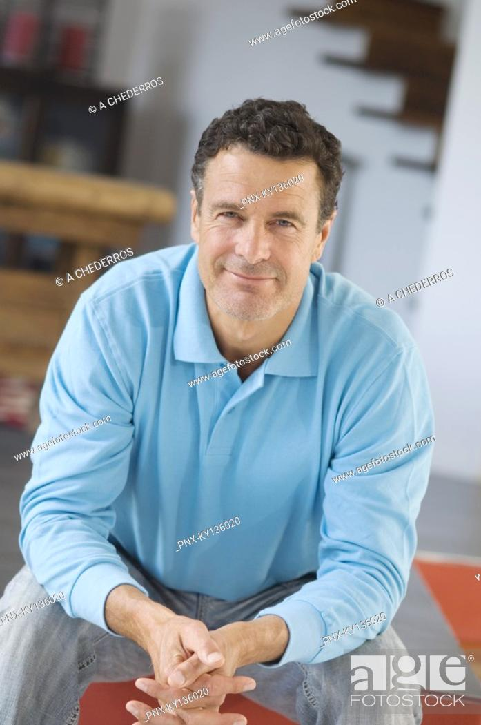 Stock Photo: Man posing for the camera, indoors.