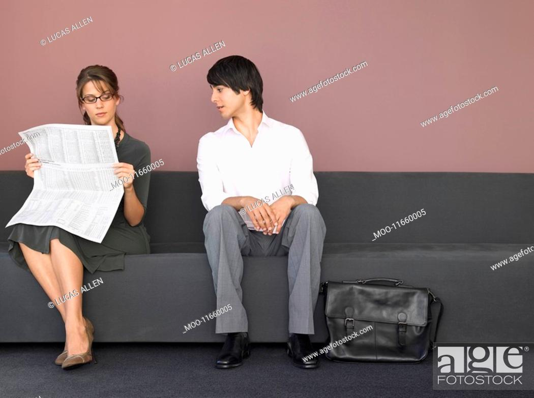 Stock Photo: Business man and woman on sofa.
