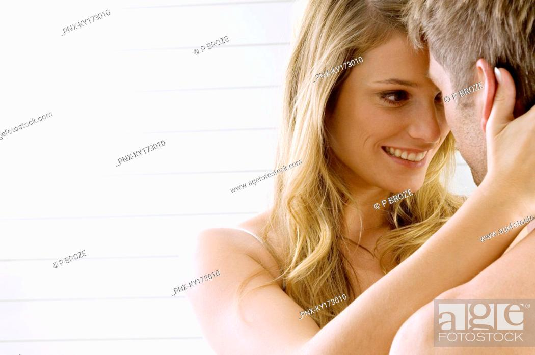 Stock Photo: Young woman and a mid adult man romancing.