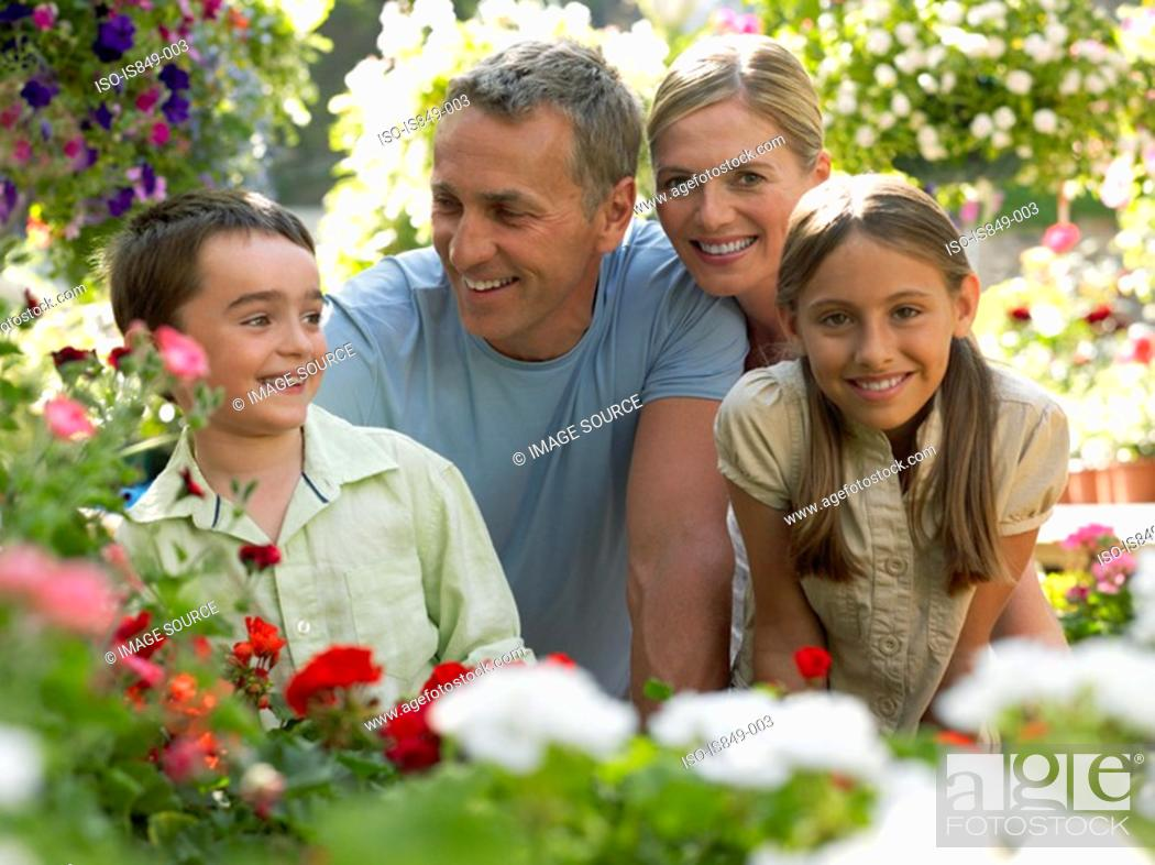 Stock Photo: Smiling family in garden.