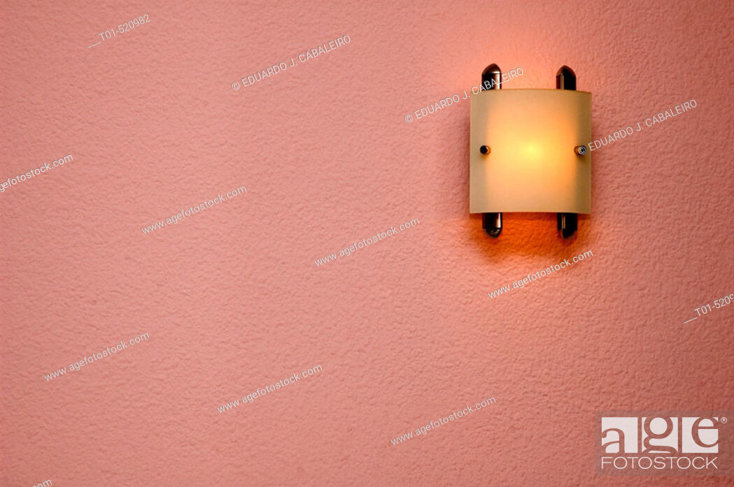 Stock Photo: light on, ceiling decorating a wall.