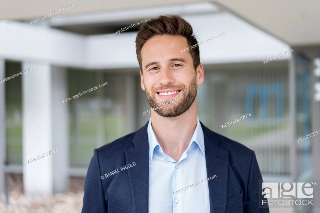 Stock Photo: Portrait of smiling businessman outdoors.
