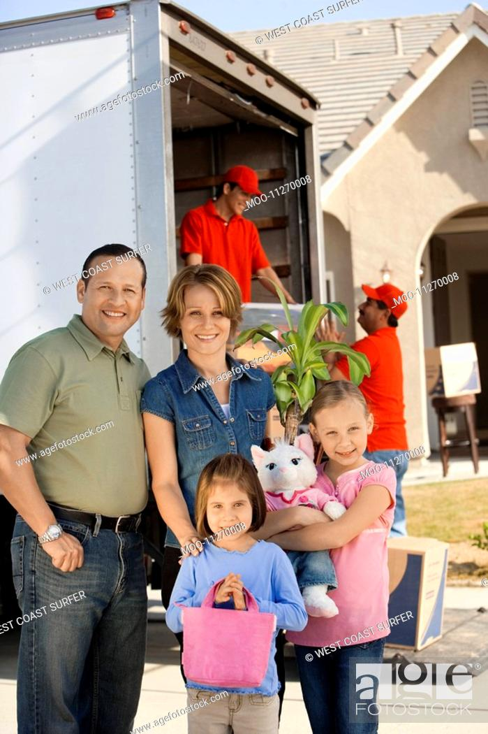 Stock Photo: Family in front of removal van and house portrait.