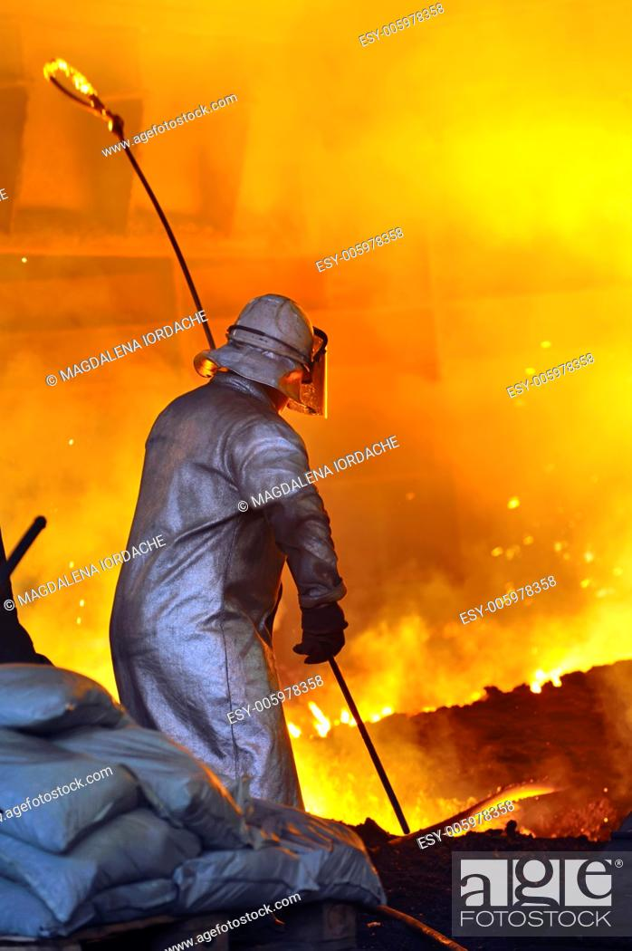 Stock Photo: worker with hot steel.