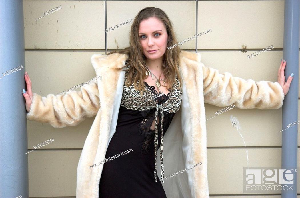 Stock Photo: Young female fashion model wearing a fur coat.