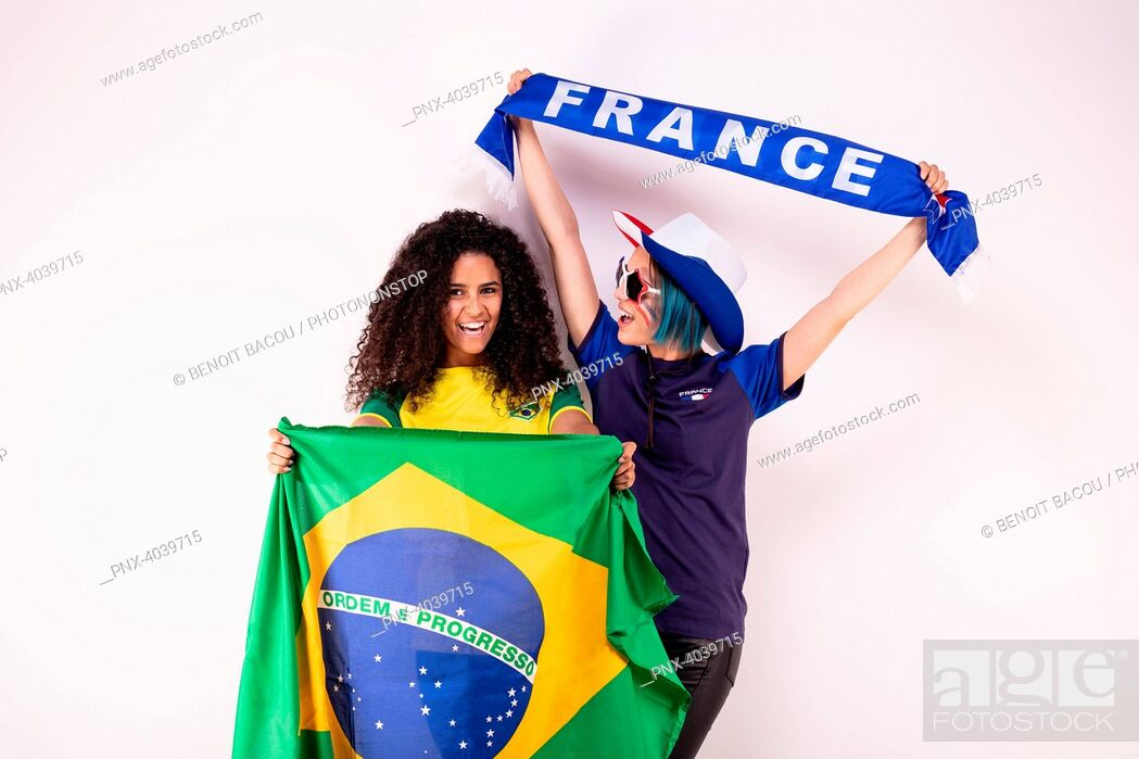 Stock Photo: Portrait of two young fans of the Brazilian team and the French fraternising team.