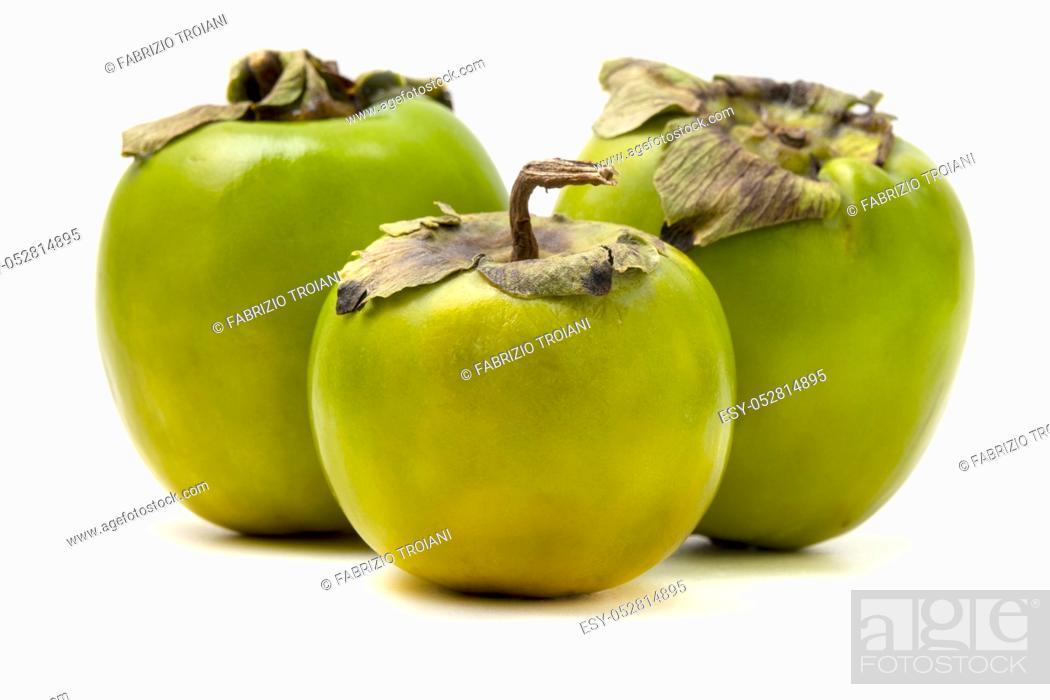 Stock Photo: Green Diospyros kaki on a white background.