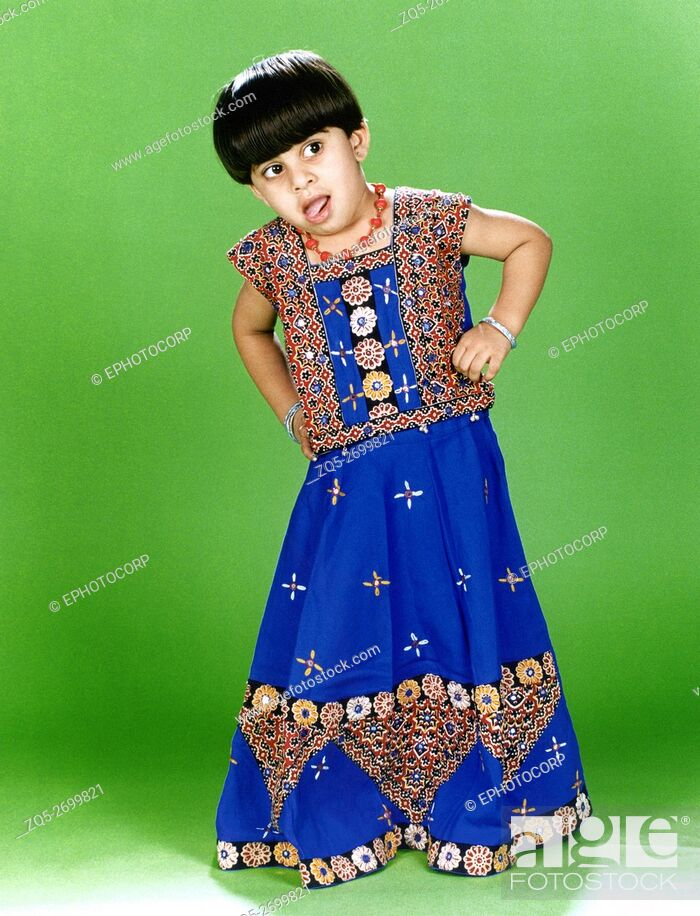 Stock Photo: A little girl wearing an embroidered 'ghagra choli', a traditional Indian attire.