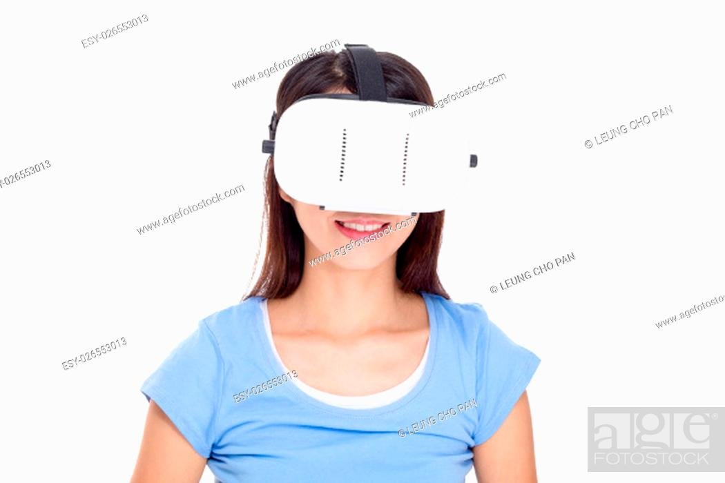 Stock Photo: Woman wearig of vr device.