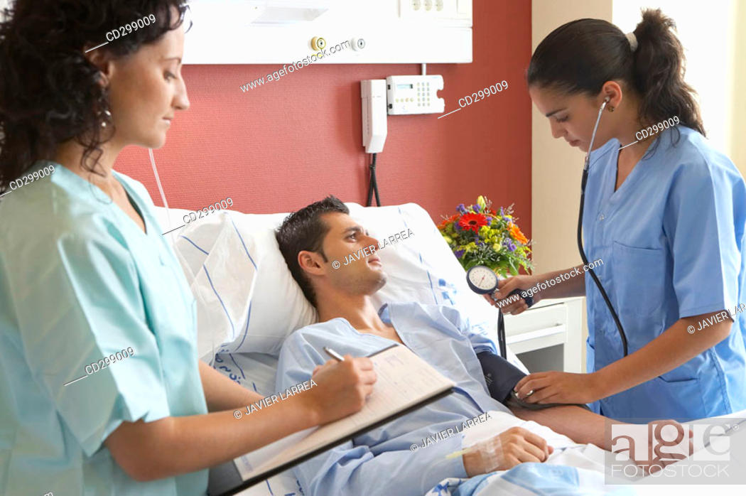 Stock Photo: Nurses and patient in hospitalization.