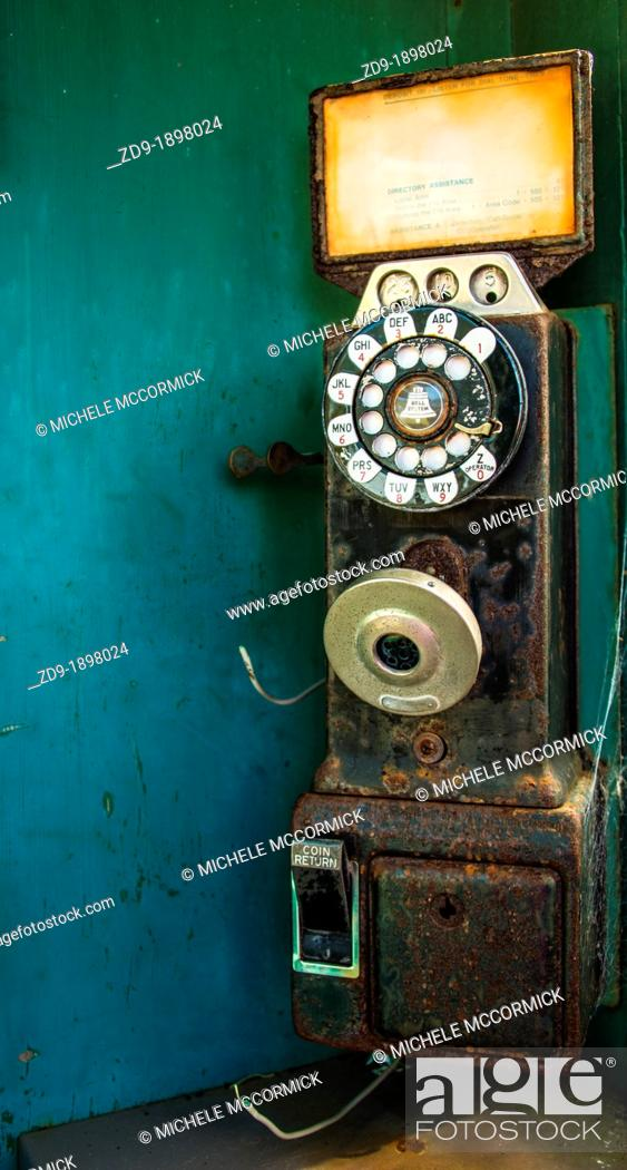 Stock Photo: A classic pay phone rusts and deteriorates on a dock in California's Bodega Bay.