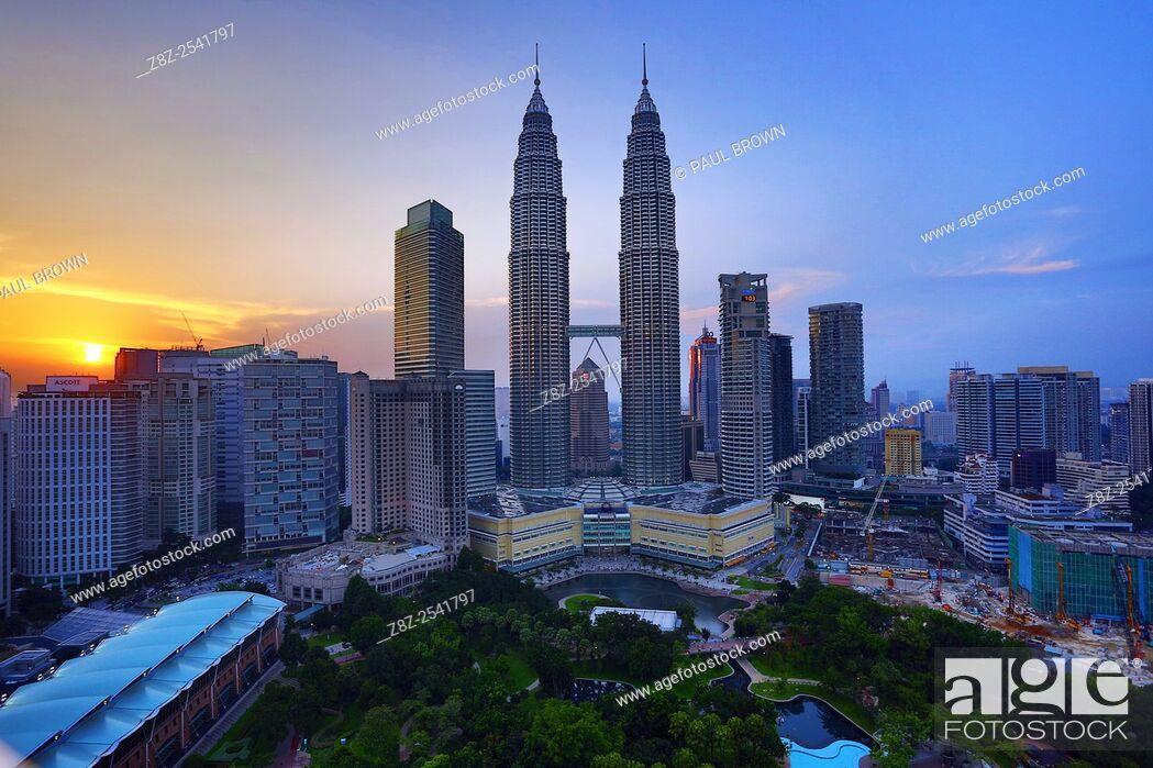 Stock Photo: Petronas Twin Towers skyscrapers at sunset, KLCC, Kuala Lumpur, Malaysia.