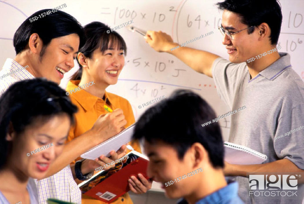 Stock Photo: Teenage students in a classroom.