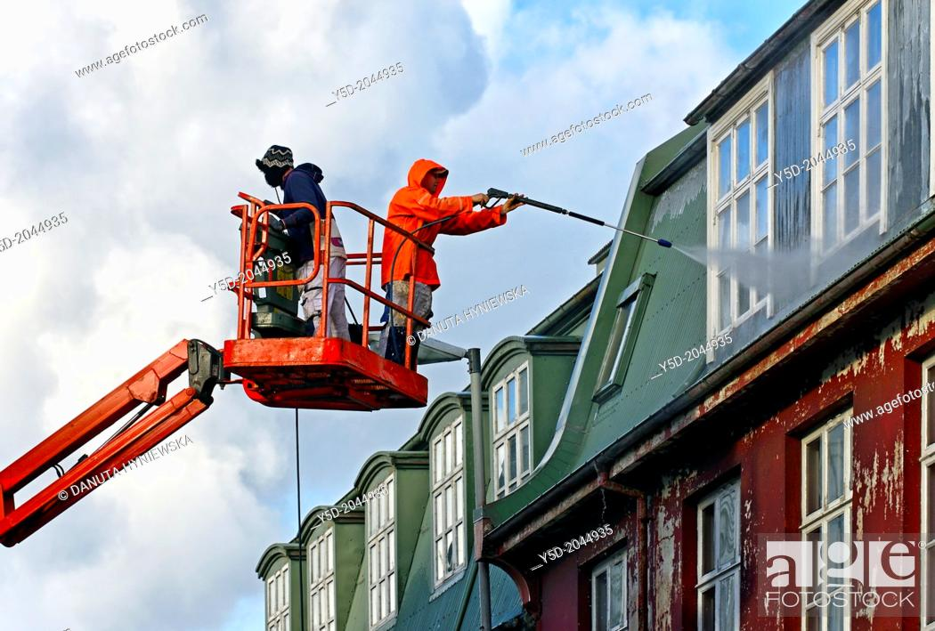 Stock Photo: cleaning windows in Reykjavik, in Iceland most windows don't have the possibility of opening, all works like cleaning or paiting or repairing must be done from.