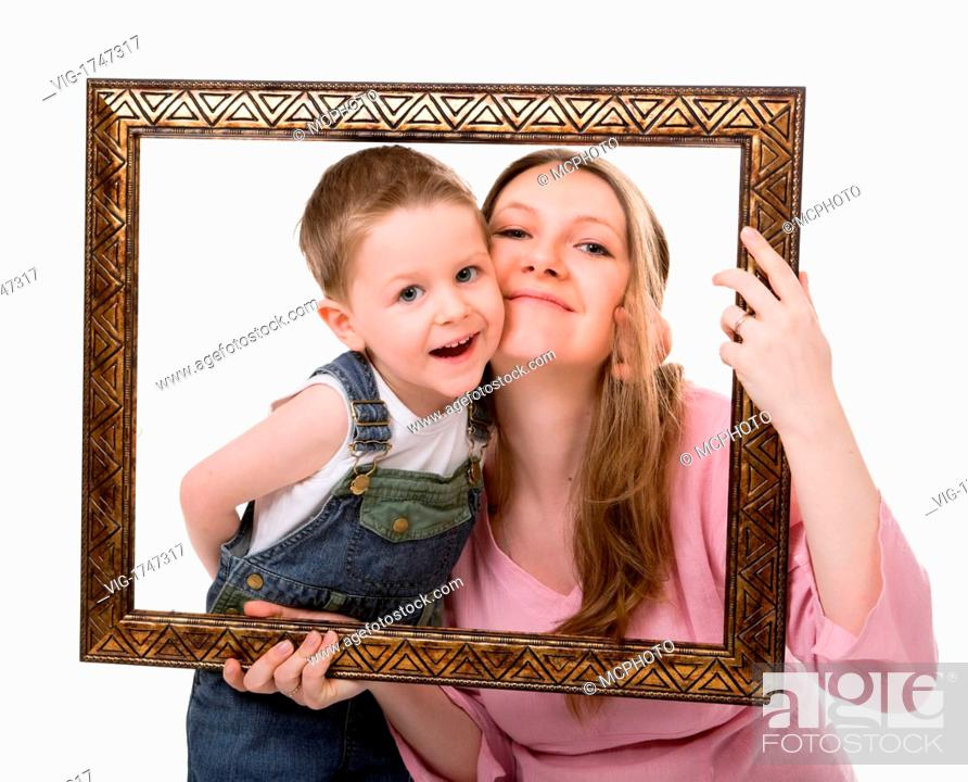 Casual Portrait Of Mother And Son Having Fun Together Playing With