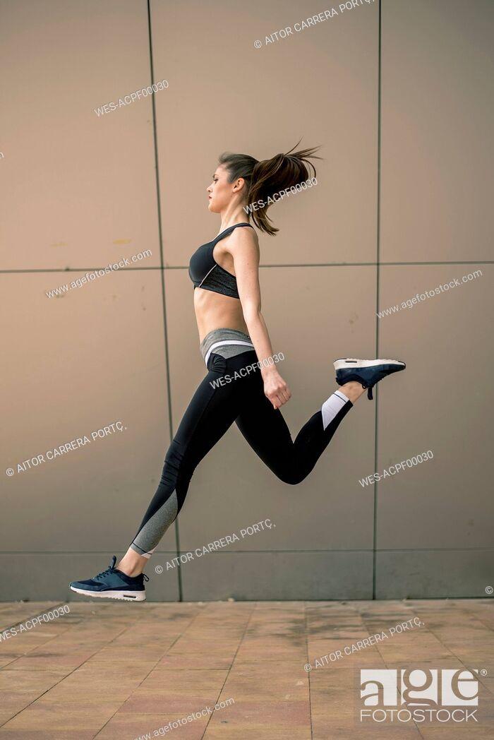 Stock Photo: Sportive woman jumping.