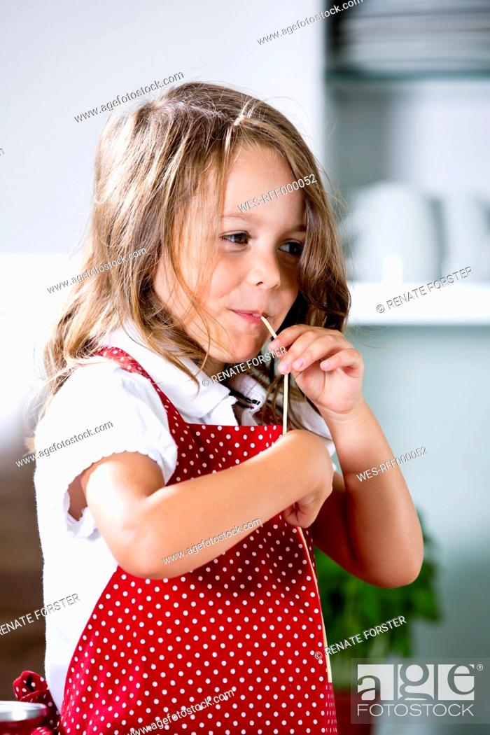 Stock Photo: Germany, Girl eating noodles.