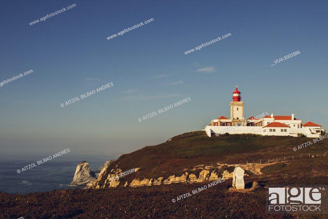 Stock Photo: Cabo da Roca lighthouse, Sintra, Lisbon, Portugal. Sunny sunset in the atlantic sea.
