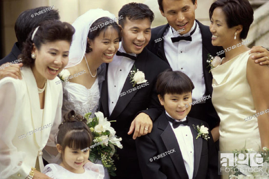 Stock Photo: Newlywed couple smiling with their friends.