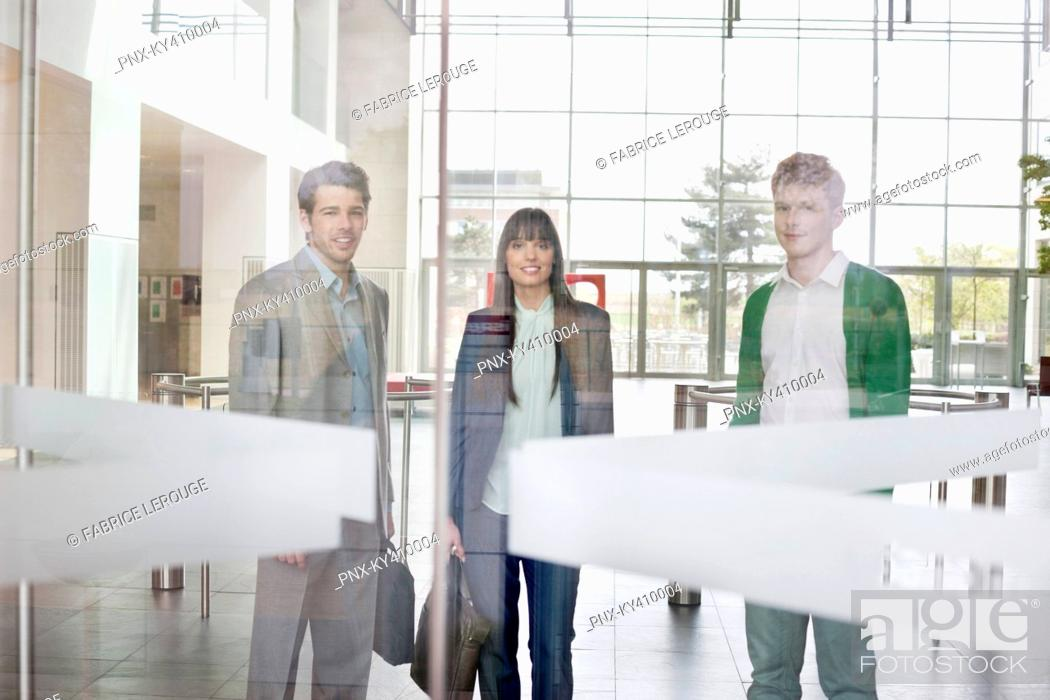 Stock Photo: Portrait of business executives in an office lobby.