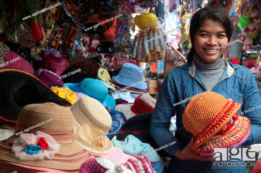 Stock Photo: Hat seller at a Cambodian country market in Ratanakiri province.