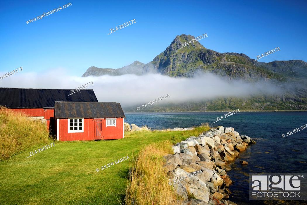 Stock Photo: Norway, Nordland, Lofoten islands, Flakstadoy island, Ramberg, Flakstad area, traditional fisherman cabin and fjord.