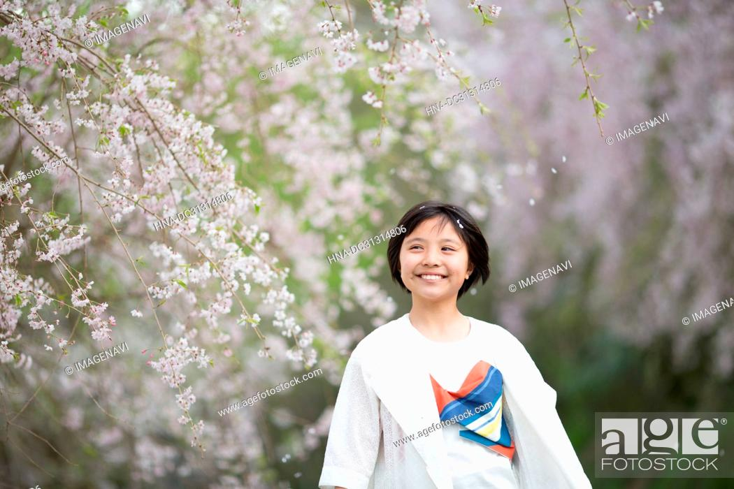 Stock Photo: Girl with Cherry blossom.