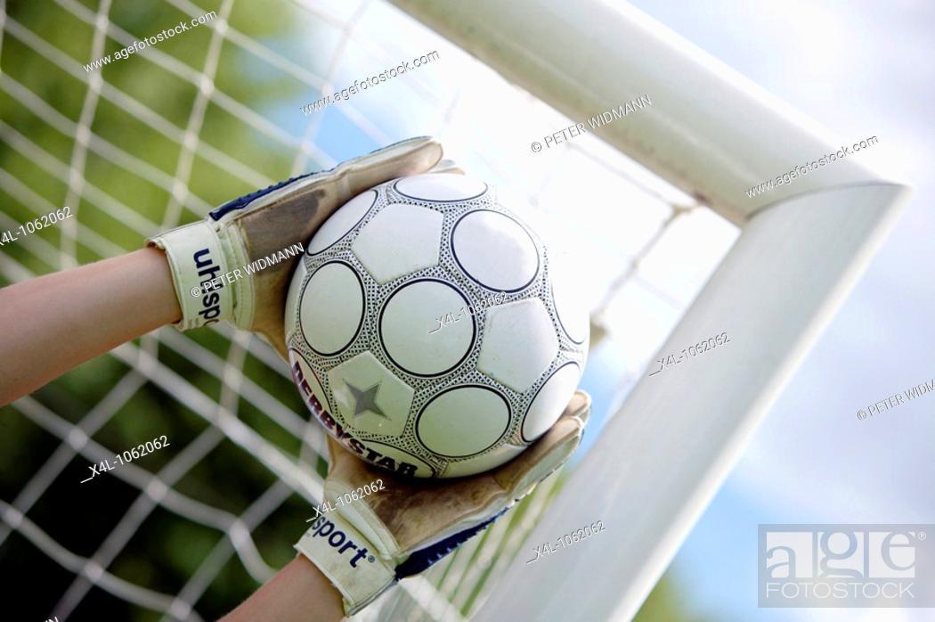 Stock Photo: football player goalkeeper keeping goal.
