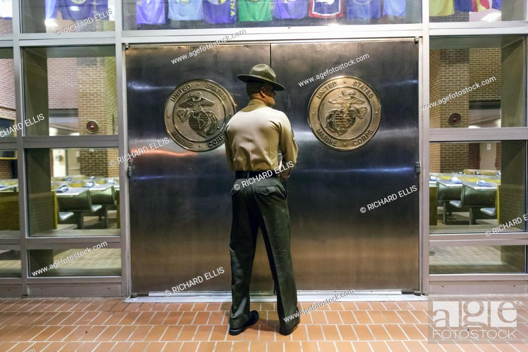 A US Marine Corps Drill Instructor shuts the chrome doors