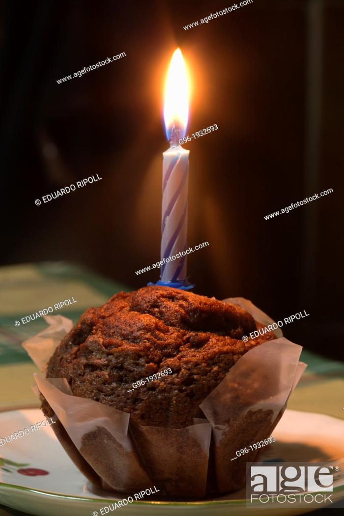 Stock Photo: muffin with candle.