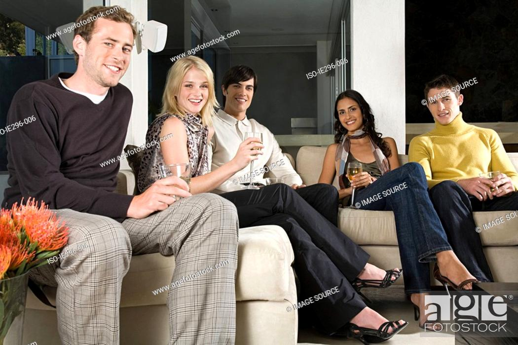Stock Photo: Friends on sofa.
